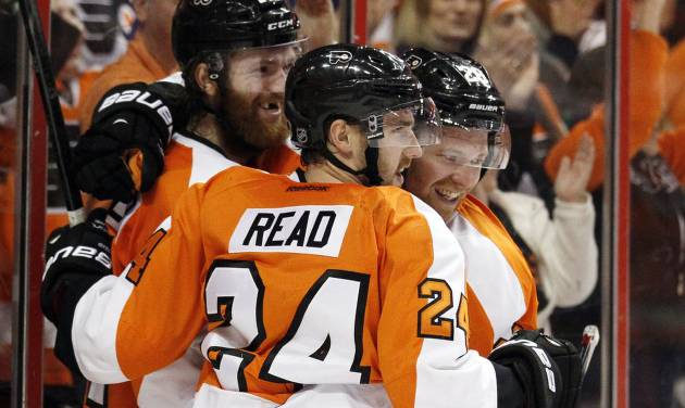 Philadelphia Flyers' Mattt Read, center, celebrates his goal along with teammates Sean Couturier, left, and Claude Giroux  during the second period of an NHL hockey game against against the Pittsburgh Penguins, Saturday, March 15, 2014, in Philadelphia. (AP Photo/Tom Mihalek)