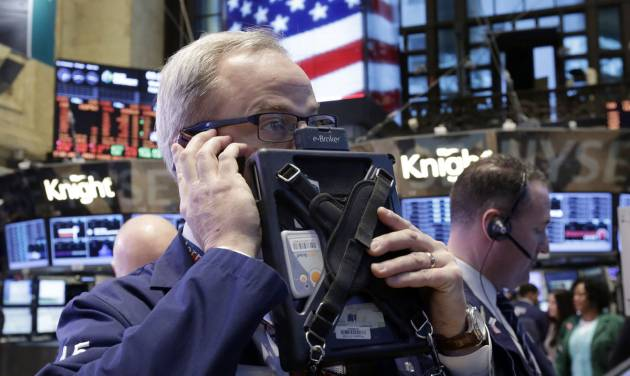 In this Wednesday, Feb. 6, 2013 photo, trader David O'Day works on the floor of the New York Stock Exchange, in New York. World stock markets were mostly higher Friday, Feb. 8, 2013, boosted by better-than-expected trade data from China that provided new evidence of an upswing in the world's second-largest economy. (AP Photo/Richard Drew)