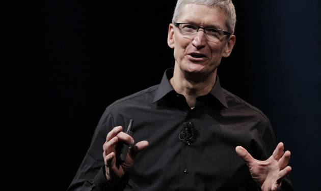 """In this Wednesday, Sept. 12, 2012 photo, Apple CEO Tim Cook speaks during an introduction of the new iPhone 5 in San Francisco. Cook says the company is """"extremely sorry"""" for the frustration that its maps application has caused and it's doing everything it can to make it better. Cook said in a letter posted online Friday Sept. 28, 2012 that Apple """"fell short"""" in its commitment to make the best possible products for its customers. (AP Photo/Eric Risberg)"""