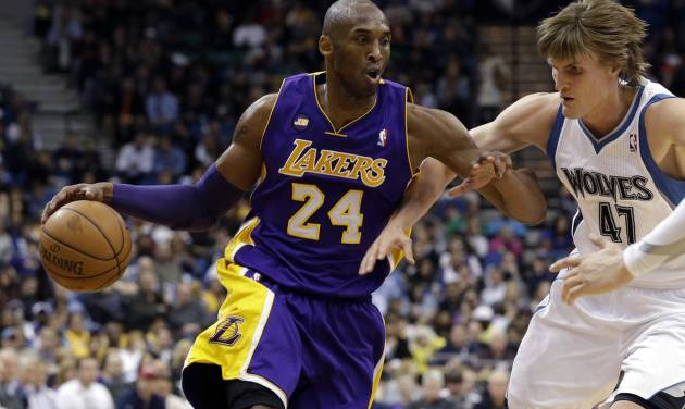 Los Angeles Lakers' Kobe Bryant, left, drives past Minnesota Timberwolves' Andrei Kirilenko of Russia in the second half of an NBA basketball game Wednesday, March 27, 2013 in Minneapolis. Bryant led the Lakers with 31 points in their 120-117 win. (AP Photo/Jim Mone)