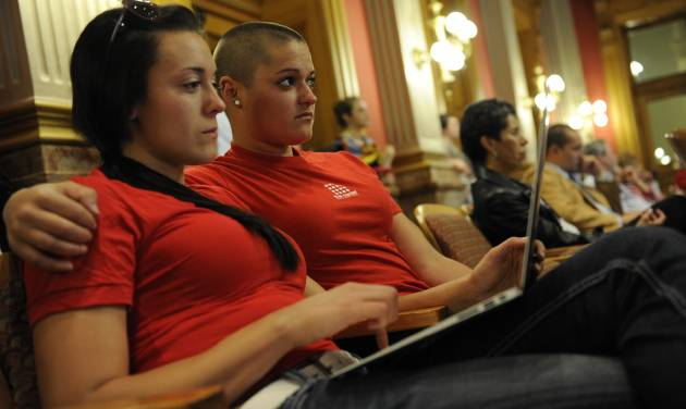 Mandalyn Starkovich, left, and Kristen Marshall wait for a hearing on Senate Bill 2 to come up in front of the House Judiciary Committee at the State Capitol in Denver, Thursday, May 3, 2012. The Colorado Civil Union Act recently passed the Senate with bipartisan support. The bill would allow same sex couple to enter into civil union. (AP Photo/The Denver Post, Craig F. Walker) MAGS OUT; TV OUT; INTERNET OUT