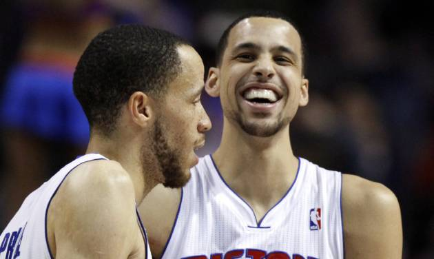 Detroit Pistons forward Austin Daye (5) laughs at a comment from Tayshaun Prince, left, after Daye hit a 3-pointer with the shot clock running out to give the Pistons a 103-97 win over the Sacramento Kings in an NBA basketball game, Tuesday, Jan. 1, 2013, in Auburn Hills, Mich. (AP Photo/Duane Burleson)