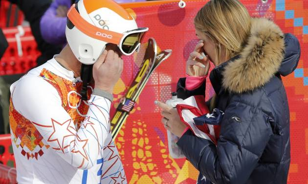 United States' Bode Miller and his wife, Morgan wipe away tears after after finishing third in the men's super-G at the Sochi 2014 Winter Olympics, Sunday, Feb. 16, 2014, in Krasnaya Polyana, Russia. (AP Photo/Christophe Ena)