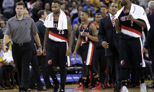 Portland Trail Blazers' Mo Williams (25) and Wesley Matthews (2) walk off the court after being ejected from an NBA basketball game against the Golden State Warriors Saturday, Nov. 23, 2013, in Oakland, Calif. (AP Photo/Ben Margot)