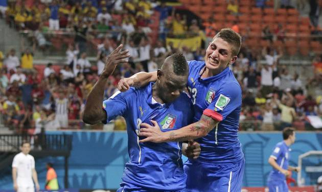 Italy's Mario Balotelli (9) celebrates with Italy's Marco Verratti (23) after Balotelli scored his side's second goal during the group D World Cup soccer match between England and Italy at the Arena da Amazonia in Manaus, Brazil, Saturday, June 14, 2014.(AP Photo/Marcio Jose Sanchez)