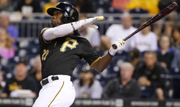 Pittsburgh Pirates' Andrew McCutchen (22) hits a two-run home run off Chicago Cubs starting pitcher Jason Hammel during the first inning of a baseball game in Pittsburgh Wednesday, June 11, 2014. (AP Photo/Gene J. Puskar)