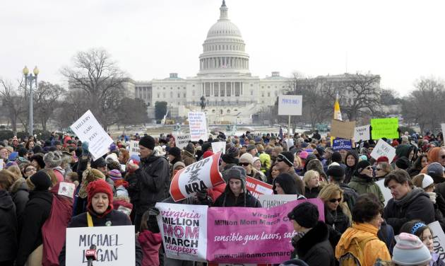 People walk from the U.S. Capitol to the Washington Monument in Washington, Saturday, Jan. 26, 2013, during a march on Washington for gun control. (AP Photo/Susan Walsh)