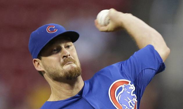 Chicago Cubs starting pitcher Travis Wood throws against the Cincinnati Reds in the first inning of a baseball game, Tuesday, Aug. 26, 2014, in Cincinnati. (AP Photo/Al Behrman)