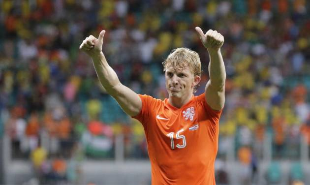 Netherlands' Dirk Kuyt gives supporters the thumbs up after the Netherlands defeated Costa Rica 4-3 in a penalty shootout after a 0-0 tie during the World Cup quarterfinal soccer match at the Arena Fonte Nova in Salvador, Brazil, Saturday, July 5, 2014. (AP Photo/Wong Maye-E)