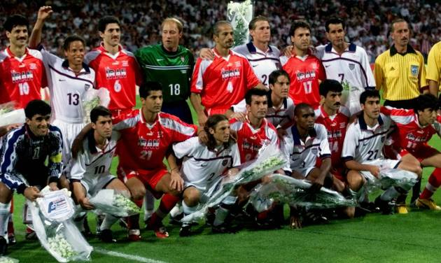 FILE - In this Sunday, June 21, 1998 file photo, US and Iranian team players pose for a group photo, before the start of their World Cup first round soccer match, at Gerland Stadium, in Lyon, France. On this day: US and Iran seek to keep lid on differences. The World Cup often throws up geopolitical clashes. (AP Photo/Michel Euler, File)