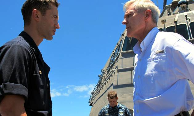 """Navy Secretary Ray Mabus, right, speaks to the USS Independence's captain, Cmdr. Joseph Gagliano, on board the ship in waters off Honolulu on Thursday, July 24, 2014. Mabus says operating costs for the service's newest ships, littoral combat ships like the Independence, will decline and """"become more normal"""" over time. (AP Photo)"""