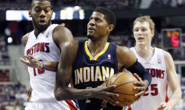 Indiana Pacers forward Paul George, center, goes to the basket against Detroit Pistons center Greg Monroe, left, and forward Kyle Singler during the second half of an NBA basketball game Saturday, Feb. 23, 2013, in Auburn Hills, Mich. George scored 12 points, pulled down 12 rebounds and dished out eight assists in the Pacers' 90-72 win. (AP Photo/Duane Burleson)