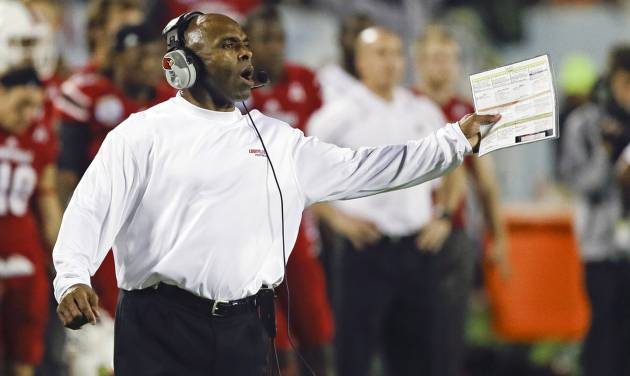 FILE - In this Dec. 28, 2013, file photo, Louisville head coach Charlie Strong calls out to players on the field during the second half of the Russell Athletic Bowl NCAA college football game against Miami in Orlando, Fla. New Texas football coach Strong says he is excited to lead one of the premier programs in the country, calling the Longhorns job a dream. In a statement released by the school formally announcing the hire Sunday, Jan. 5, 2014, Strong called Texas a special program because of its history, tradition and pride. (AP Photo/John Raoux, File)