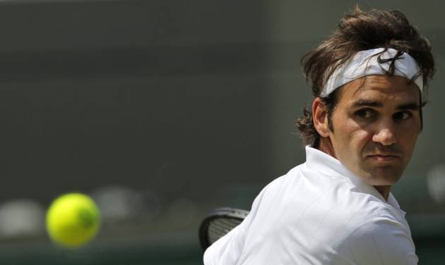 Roger Federer of Switzerland returns to Tommy Robredo of Spain during their men's singles match at the All England Lawn Tennis Championships in Wimbledon, London, Tuesday  July 1, 2014. (AP Photo/Pavel Golovkin)