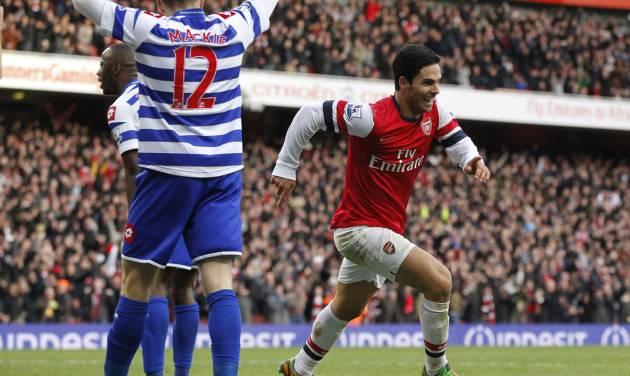 Arsenal's Mikel Arteta, right, celebrates his goal against Queens Park Rangers during their English Premier League soccer match at Emirates stadium, London, Saturday, Oct. 27, 2012. (AP Photo/Sang Tan)