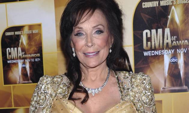 "FILE - In this Nov. 10, 2010 file photo, singer Loretta Lynn poses in the press room during the 44th Annual Country Music Awards in Nashville, Tenn. Newly discovered documents indicate country music legend Loretta Lynn is three years older than she has led people to believe, a change that undermines the story told in ""Coal Miner's Daughter."" (AP Photo/Evan Agostini, File)"