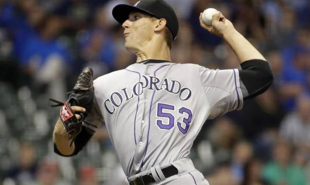 Colorado Rockies starting pitcher Christian Friedrich throws during the first inning of a baseball game against the Milwaukee Brewers Thursday, June 26, 2014, in Milwaukee. (AP Photo/Morry Gash)