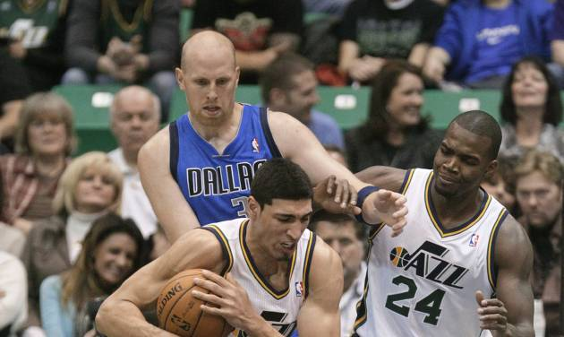 Utah Jazz center Enes Kanter (0) pulls down a rebound as Mavericks small forward Jae Crowder falls to his knees while Mavericks center Chris Kaman (35) and Jazz forward Paul Millsap (24) look on in the second quarter during an NBA basketball game Monday, Jan. 7, 2013, in Salt Lake City. (AP Photo/Rick Bowmer)
