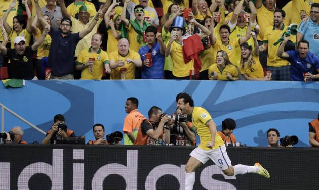Brazil's Fred celebrates after scoring his side's third goal during the group A World Cup soccer match between Cameroon and Brazil at the Estadio Nacional in Brasilia, Brazil, Monday, June 23, 2014. (AP Photo/Bernat Armangue)