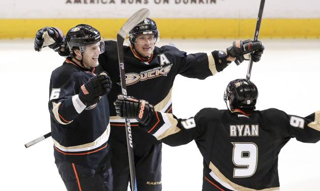 Anaheim Ducks right wing Teemu Selanne, middle, celebrates his goal with Ben Lovejoy, left, and Bobby Ryan against the Detroit Red Wings during the third period in Game 1 of their first-round NHL hockey Stanley Cup playoff series in Anaheim, Calif., Tuesday, April 30, 2013. (AP Photo/Chris Carlson)