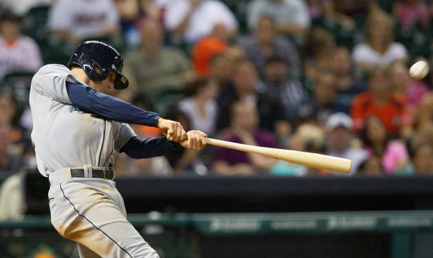 Seattle Mariners' Brad Miller drives the ball to right field for a three-run home run against the Houston Astros in the eighth inning during a baseball game Friday, July 19, 2013, in Houston. (AP Photo/Bob Levey)