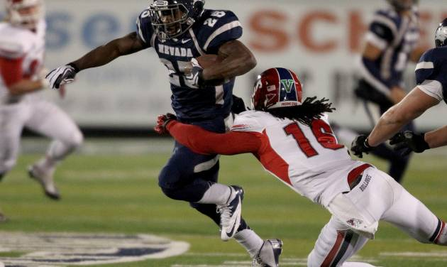 Nevada's Stefphon Jefferson (25) breaks a tackle from Fresno State's Phillip Thomas (16) during the first half of an NCAA college football game in Reno, Nev., on Saturday, Nov. 10, 2012. (AP Photo/Cathleen Allison) ORG XMIT: NVCA104