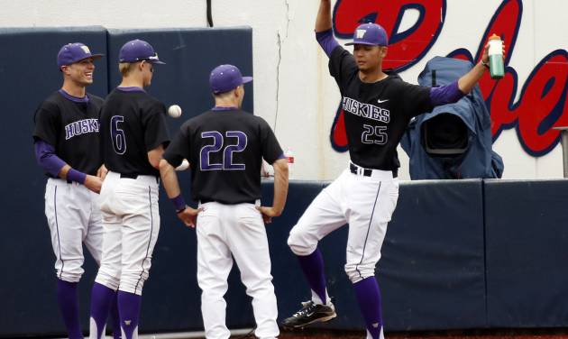 Washington baseball players joke around as they wait out a rain delay Friday afternoon, May 30, 2014, before playing the first baseball game against Georgia Tech during an NCAA college baseball regional tournament in Oxford, Miss. (AP Photo/Rogelio V. Solis)