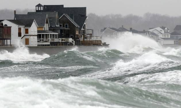 Wind-driven waves come ashore in Scituate, Mass., Wednesday, March 26, 2014. Cape Cod and the islands were expected to bear the brunt of the spring storm that struck full force Wednesday. The storm could drop up to 10 inches of snow. (AP Photo/Michael Dwyer)
