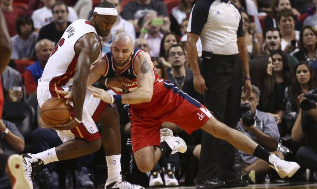 Washington Wizards' Marcin Gortat, right, tries to steal the ball from Miami Heat's LeBron James (6) during the first half of an NBA basketball game in Miami, Sunday, Nov. 3, 2013. (AP Photo/J Pat Carter)