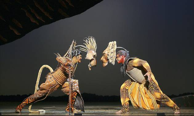 "Timothy Carter and Dionne Randolph perform in a scene from ""The Lion King,"" being staged at Civic Center Music Hall through May 24. PHOTO BY JOAN MARCUS, COPYRIGHT DISNEY"
