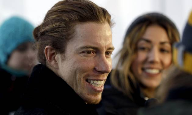 FILE - In this Dec. 14, 2012, file photo, Shaun White smiles during a television interview in Breckenridge, Colo. White on Wednesday, Feb. 5, 2014 said that he is pulling out of the Olympic slopestyle contest to focus solely on winning a third straight gold medal on the halfpipe. (AP Photo/Brennan Linsley, File)