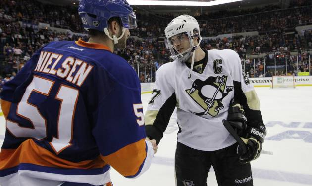 New York Islanders center Frans Nielsen (51), of Denmark, congratulates Pittsburgh Penguins center Sidney Crosby (87) after the Penguins defeated the Islanders in overtime of Game 6 of a first-round NHL Stanley Cup playoff hockey series in Uniondale, N.Y., Saturday, May 11, 2013.  The top-seeded Penguins advanced to the Eastern Conference semifinals with a 4-3 win. (AP Photo/Kathy Willens)