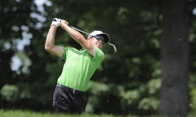 Scott Langley watches his approach shot on the ninth hole during the second round of the Travelers Championship golf tournament in Cromwell, Conn., Friday, June 20, 2014. (AP Photo/Fred Beckham)