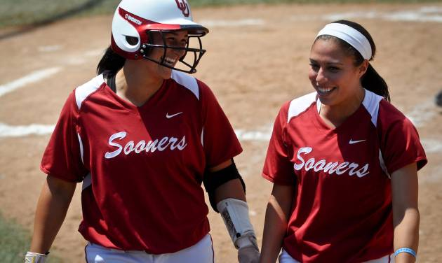 Oklahoma infielder Lauren Chamberlain (left) celebrates her home run with outfielder Destinee Martinez (right) in the final game of the seasons Bedlam series held in Stillwater, Okla. on May 12, 2013.  KT King/For the Oklahoman KOD