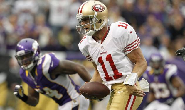 San Francisco 49ers quarterback Alex Smith (11) scrambles for yardage during the second half of an NFL football game against the Minnesota Vikings Sunday, Sept. 23, 2012, in Minneapolis. The Vikings won 24-13. (AP Photo/Genevieve Ross)