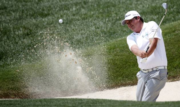 Jason Dufner hits out of the bunker on the fifth hole during a practice round for the PGA Championship golf tournament at Valhalla Golf Club on Wednesday, Aug. 6, 2014, in Louisville, Ky. The tournament is set to begin on Thursday. (AP Photo/Mike Groll)