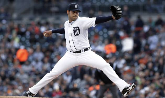 Detroit Tigers pitcher Anibal Sanchez throws against the Atlanta Braves in the first inning of a baseball game in Detroit, Friday April 26, 2013.  (AP Photo/Paul Sancya)