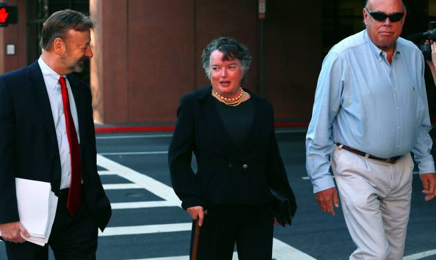 Former San Diego mayor Maureen O'Connor, center, walks to federal court in San Diego Thursday, Feb. 14, 2013, with her attorney Eugene Iredale, left. O'Connor admitted in federal court that she misappropriated $2 million from her late husband's charitable foundation due to a gambling addiction in which won more than $1 billion but lost even more over nearly a decade. O'Connor made the acknowledgement Thursday in an agreement with the government to defer prosecution for two years while she attempts to repay the debt. (AP Photo/UT San Diego, Peggy Peattie) SAN DIEGO COUNTY OUT; NO SALES; COMMERCIAL INTERNET OUT; FOREIGN OUT NO SALES, ONLINE OUT, NO ARCHIVING, SAN DIEGO COUNTY OUT, TV OUT, MAGS OUT, NO FORNS.  TABLOIDS OUT. WIDE WORLD OUT. COMMERCIAL INTERNET USE OUT.
