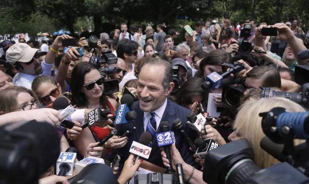 Former New York governor Eliot Spitzer is surrounded by media as he tries to collect signatures for his run for New York City Comptroller in New York, Monday, July 8, 2013. Spitzer, who stepped down in 2008 amid a prostitution scandal, says he is planning a political comeback with a run for New York City comptroller. (AP Photo/Seth Wenig)