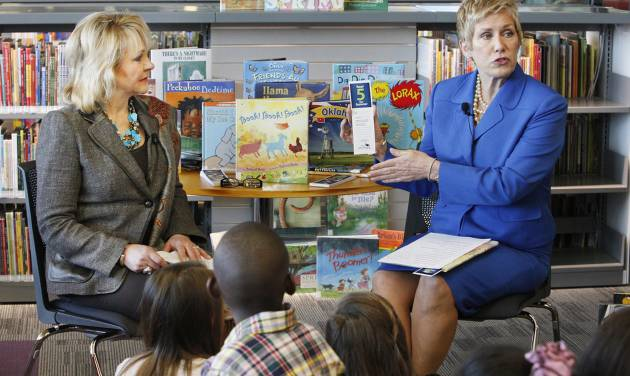 Gov. Mary Fallin looks on as State Superintendent of Public Instruction Janet Barresi shows a bookmark to students from James L. Dennis Elementary School at the Patience S. Latting Northwest Library in Oklahoma City Friday, May 3, 2013. The governor and superintendent were kicking off the State Department of Education's 2013 Summer Reading Program called Read 5 for Summer by reading to the students. Photo by Paul B. Southerland, The Oklahoman