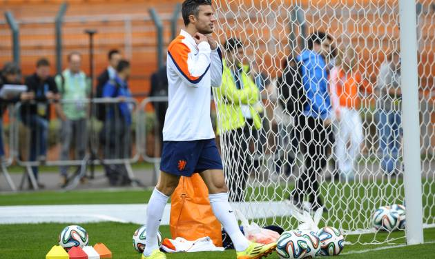 Netherlands's Robin van Persie arrives for a training session one day before their World Cup semifinal soccer match against Argentina at the Paulo Machado de Carvalho Stadium in Sao Paulo, Brazil, Tuesday, July 8, 2014. (AP Photo/Manu Fernandez)