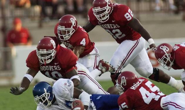 OU vs Indiana State football. OU defense stops Matt Nelson. 10 Torrance Marshall, 4 Pee Wee Woods, 92 Corey Callens, 45 Rodney Rideau