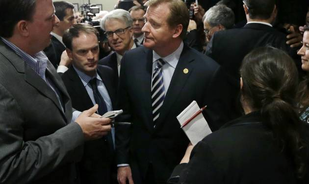 NFL football commissioner Roger Goodell is surrounded by reporters after delivering a Dean's Distinguished Lecture at Harvard School of Public Health in Boston, Thursday, Nov. 15, 2012, where he discussed some of the rules that have been created to limit concussions in the game of football. Goodell said the league will do what it needs to do to protect the safety of its 1,800 players. (AP Photo/Elise Amendola)