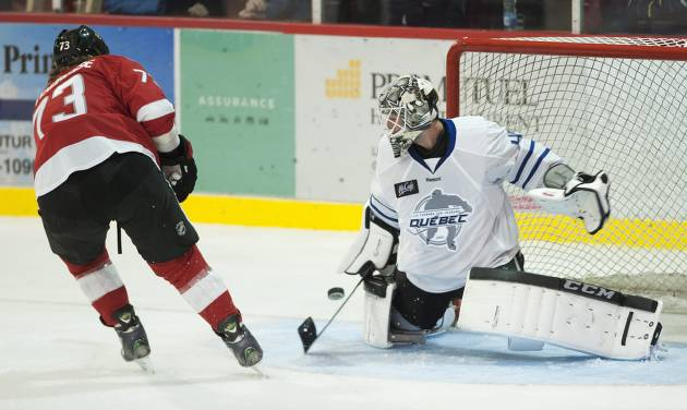 Los Angeles Kings goaltender Jonathan Bernier makes a save against Ottawa Senators' Guillaume Latendresse during first period of a charity hockey game in Chateauguay, Quebec, Thursday, Sept. 27, 2012. (AP Photo/The Canadian Press, Graham Hughes)