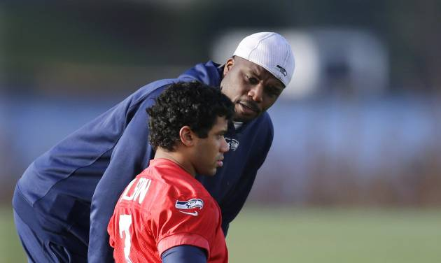 FILE - In this Jan. 3, 2014, file photo, Seattle Seahawks defensive assistant Marquand Manuel, right, talks with  quarterback Russell Wilson (3) before NFL football practice in Renton, Wash. Manuel , a defensive assistant on Pete Carroll's staff,  is also the only player or coach who was on Seattle's only other Super Bowl team, which lost to Pittsburgh in 2006. (AP Photo/Ted S. Warren, File)