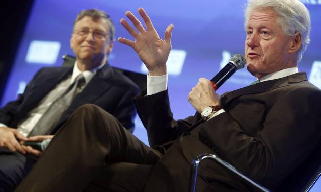 Former President Bill Clinton and Microsoft founder and philanthropist Bill Gates, speak about debt at the 2013 Fiscal Summit in Washington, Tuesday, May 7, 2013. (AP Photo/Charles Dharapak)
