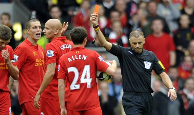 Referee Mark Halsey, right, gives Liverpool's Jonjo Shelvey, second left, a red card during their English Premier League soccer match at Anfield in Liverpool, England, Sunday Sept. 23, 2012. (AP Photo/Clint Hughes)