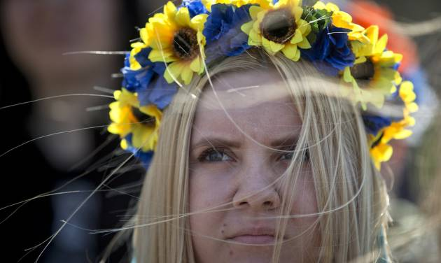 A pro-Ukrainian demonstrator attends a rally, in Simferopol, Ukraine, Saturday, March 15, 2014. Tensions are high in the Black Sea peninsula of Crimea, where a referendum is to be held Sunday on whether to split off from Ukraine and seek annexation by Russia. (AP Photo/Vadim Ghirda)