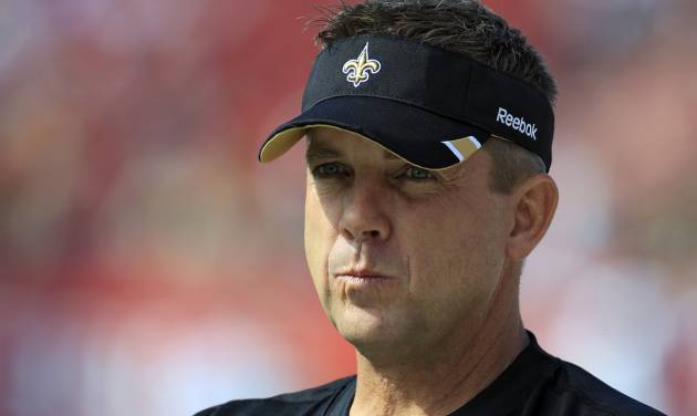 FILE - This Oct. 16, 2011 file photo shows New Orleans Saints head coach Sean Payton watching his team warm up for an NFL game against the Tampa Bay Buccaneers, in Tampa, Fla. NFL Commissioner Roger Goodell has rejected the appeals of coach Sean Payton and other New Orleans Saints officials stemming from the league's probe into the club's bounty system. After hearing from Payton, general manager Mickey Loomis and assistant head coach Joe Vitt last week, Goodell decided Monday, April 9, 2012, to uphold his initial sanctions, which include Payton's suspension for the entire 2012 season. (AP Photo/Chris O'Meara, File)