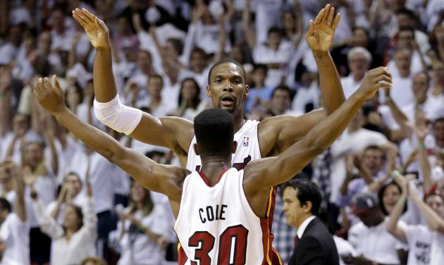 Miami Heat's Chris Bosh and Norris Cole (30) celebrate after the Heat defeated the Chicago Bulls 94-91 in Game 5 of an NBA basketball Eastern Conference semifinal, Wednesday, May 15, 2013, in Miami. The win sent the Heat to the conference finals. (AP Photo/Wilfredo Lee)